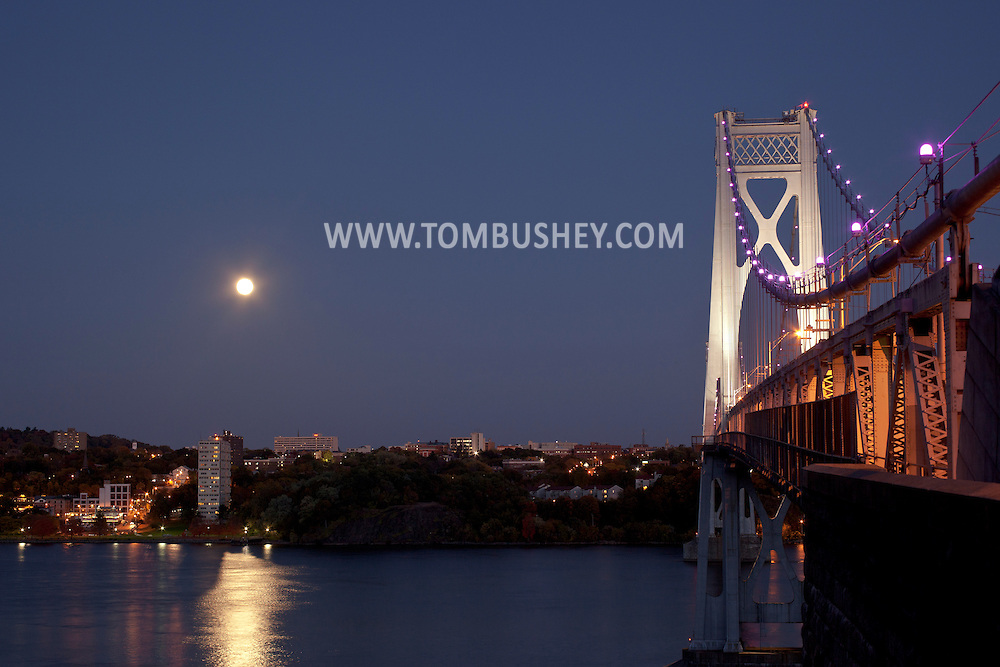 Highland, New York - The full moon rises over Poughkeepsie on Oct. 18, 2013. The Mid-Hudson Bridge is at right.