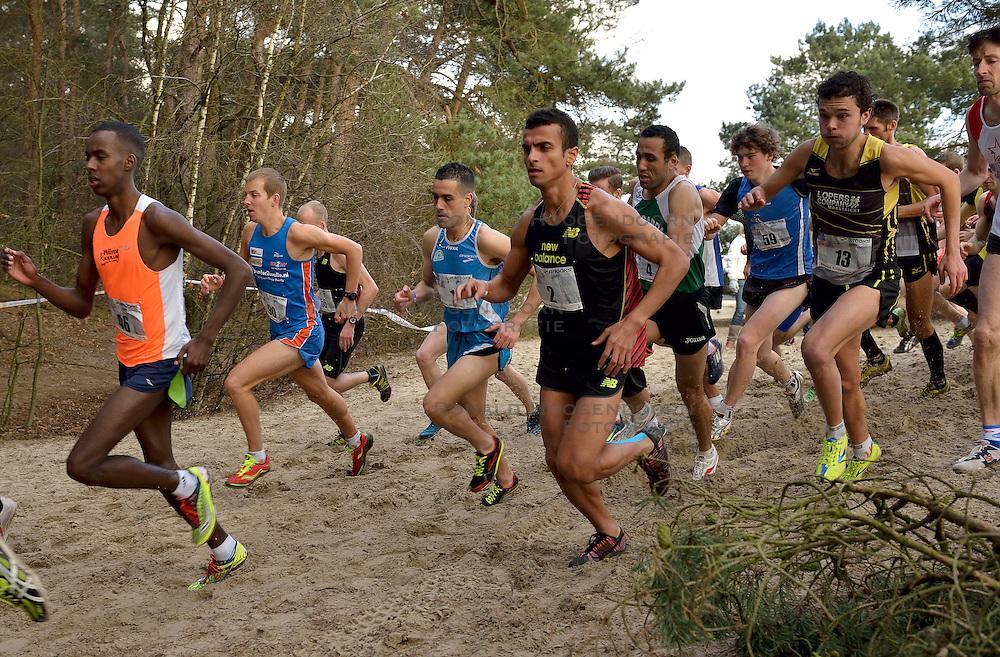31-12-2014 NED: Rabobank Sylvestercross, Soest<br /> Khalid Choukoud is voor de tweede keer winnaar geworden van de Sylvestercross in Soest. Roman Romarenko (3), de kampioen van Oekra&iuml;ne, finishte op dertien seconden als tweede en de Belg Soufiane Bouchiki (2) eindigde op twintig seconden als derde.