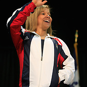 Olympic gymnast Shawn Johnson waves to an overflow crowd on July 14 in Des Moines, Iowa, as she was given a Beijing send-off at a rally at HyVee Hall.  Johnson is the favorite for the all-around gold medal at this year's Olympic Games in China, having won the U.S. Trials, as well as the World Championships in 2007.  Johnson, who  lives in West Des Moines, Iowa, has become one of the most recognizable faces for the American Olympic team.  photo by David Peterson Olympics,Des Moines,send-off,rally,Shawn Johnson,track&field,100 meter hurdles,excited,happy,smile,coach,sport,Beijing,China,Iowa,celebration,gymnastics,flood,gold medal,winner,compete,America,Liang Chow