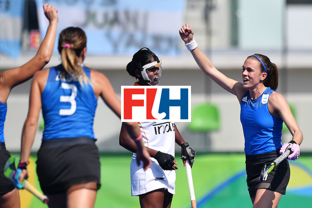 Argentina's Carla Rebecchi (R) celebrates scoring with her team-mates during the women's field hockey Argentina vs India match of the Rio 2016 Olympics Games at the Olympic Hockey Centre in Rio de Janeiro on August, 13 2016. / AFP / Carl DE SOUZA        (Photo credit should read CARL DE SOUZA/AFP/Getty Images)