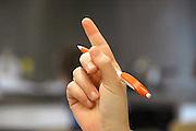 Nederland, Nijmegen, 19-10-2012VMBO school. Een leerling steekt haar vinger in de lucht om de attentie van de leraar te krijgen.Foto: Flip Franssen/Hollandse Hoogte