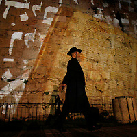Ultra orthodox Jewish walks in front of the Jerusalem's Old City walls. February 2008.