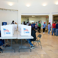 Voters line up at the McKinley County Courthouse to cast their vote in the mid-term elections, Tuesday Nov. 6. in Gallup.