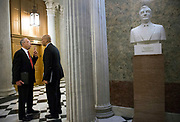 Sen. Chuck Grassley (R-IA) (L) talks to Sen. Cory Booker (D-NJ) prior to a vote on Capitol Hill.