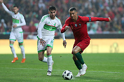 June 7, 2018 - Lisbon, Portugal - Portugal's forward Cristiano Ronaldo (R ) vies with AlgeriaÂ«s defender Carl Medjani during the FIFA World Cup Russia 2018 preparation football match Portugal vs Algeria, at the Luz stadium in Lisbon, Portugal, on June 7, 2018. (Credit Image: © Pedro Fiuza via ZUMA Wire)