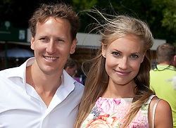 © licensed to London News Pictures. LONDON, UK  23/05/2011. Chelsea Flower Show, Press Day. Dancer Brendan Cole with Zoe Hobbs, a British model. Please see special instructions for usage rates. Photo credit should read Bettina Strenske/LNP