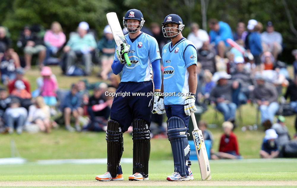 Martin Guptill and Azhar Mahmood take a moment between over's to assess the Aces position.<br /> Twenty20 Cricket - HRV Cup, Otago Volts v Auckland Aces, 15 January 2012, University Oval, Dunedin, New Zealand.<br /> Photo: Rob Jefferies / photosport.co.nz