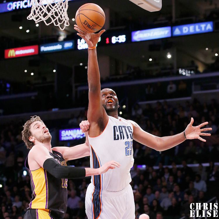 31 January 2014: Charlotte Bobcats center Al Jefferson (25) goes for the layup past Los Angeles Lakers center Pau Gasol (16) during the Charlotte Bobcats 110-100 victory over the Los Angeles Lakers at the Staples Center, Los Angeles, California, USA.