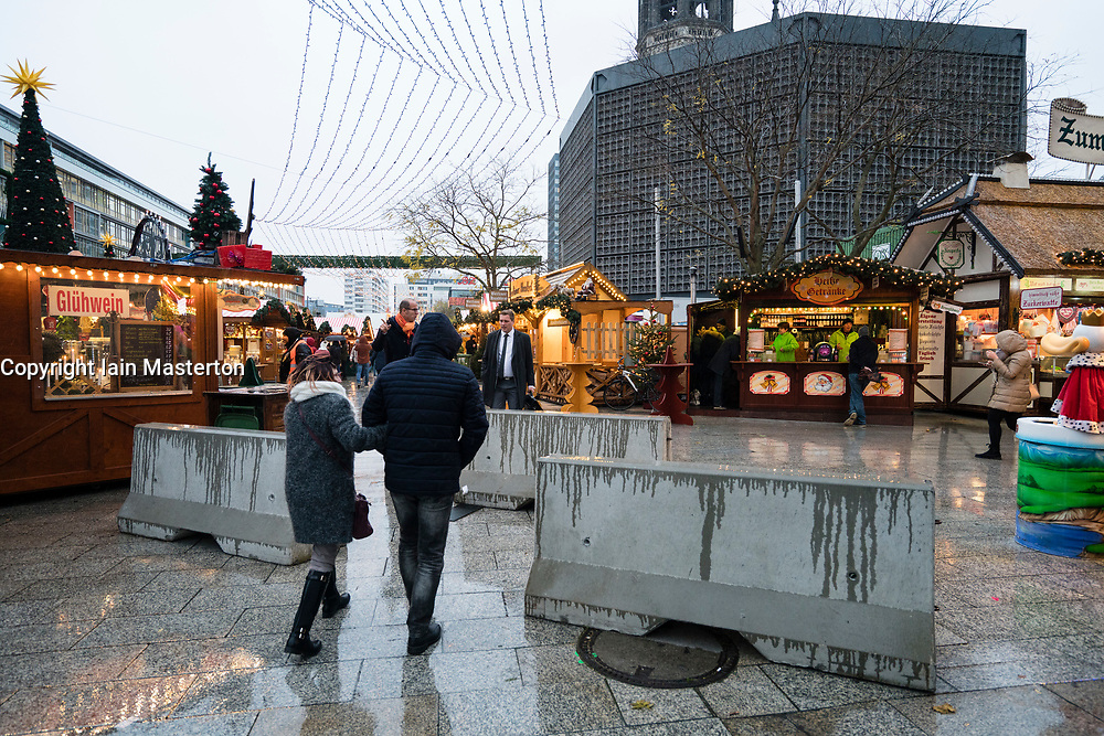 Berlin, Germany. 27th November, 2017. Christmas market starts at Breitscheidplatz at scene of lorry terror attack in 2016. Concrete blocks have been installed at the entrances to the market as a security measure this year.