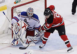 Oct 5, 2009; Newark, NJ, USA; New York Rangers goalie Henrik Lundqvist (30) makes a save on a tip by New Jersey Devils left wing Zach Parise (9) during the third period at the Prudential Center. The Rangers defeated the Devils 3-2.
