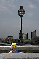 Athlete standing between river embankment ledges London England