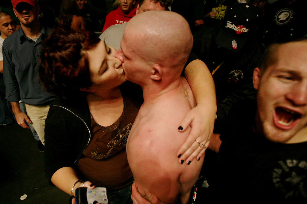 Kyle Green   The Roanoke Times<br /> October 07, 2006 Stephenie Wyatt (left, age 19) gives a post fight kiss to her husband, Joel Wyatt (age 20), after his &quot;Rucus in the Cage&quot; mixed martial arts fight held at the Roanoke Civic Center October 7th. Joel defeated previously undefeated light heavyweight champion, 205 pound U.S. Marine, Michael Smith, by round 3 TKO October 7th at the Roanoke Civic Center in Roanoke, Virginia.
