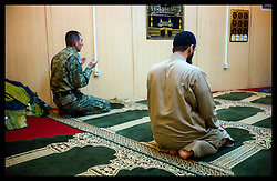 Imam Asim Hafiz praying in the Mosque at the Issaf Hq in Kabul  18th January 2014 . Picture by Andrew Parsons / Parsons Media Ltd