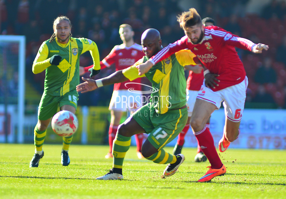 Notts County's Leroy Lita battles for the ball  during the Sky Bet League 1 match between Swindon Town and Notts County at the County Ground, Swindon, England on 7 March 2015. Photo by Mark Davies.