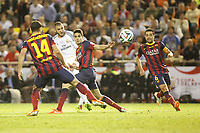 Real Madrid´s Karim Benzema (L) and F.C. Barcelona´s Bartra and Xavi during the Spanish Copa del Rey `King´s Cup´ final soccer match between Real Madrid and F.C. Barcelona at Mestalla stadium, in Valencia, Spain. April 16, 2014. (ALTERPHOTOS/Victor Blanco)