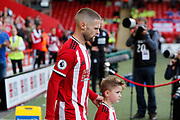 Ollie Norwood of Sheffield United leads the team out for the Premier League match between Sheffield United and Crystal Palace at Bramall Lane, Sheffield, England on 18 August 2019.