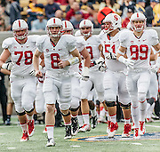BERKELEY, CA -  NOVEMBER 22:  Quarterback Kevin Hogan #8 leads his Stanford Cardinal teammates onto the field during a PAC-12 NCAA football game against the California Golden Bears in the 117th Big Game played on November 22, 2014 at Memorial Stadium on the University of California campus in Berkeley, California.   Visible players include Kyle Murphy #78, Joshua Garnet #51, and Devon Cajuste #89.   (Photo by David Madison/Getty Images) *** Local Caption *** Kevin Hogan