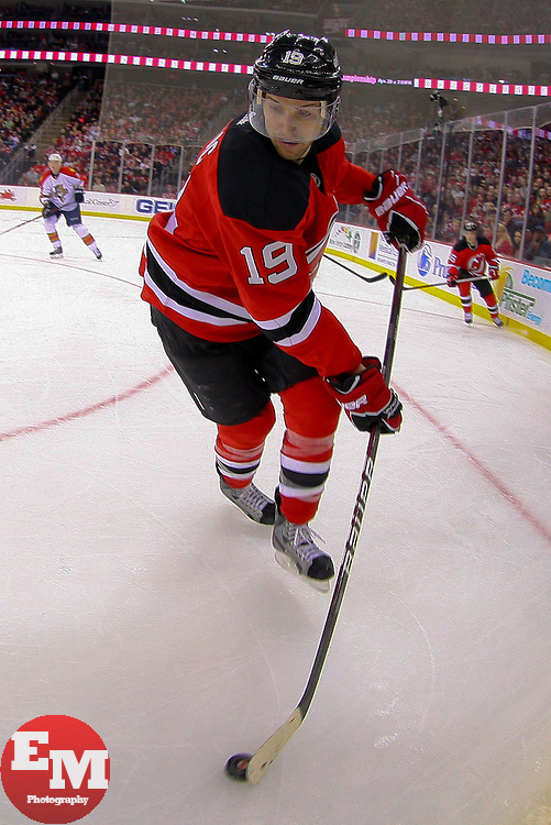 Mar 23, 2013; Newark, NJ, USA; New Jersey Devils center Travis Zajac (19) skates with the puck during the third period at the Prudential Center. The Devils defeated the Panthers 2-1.