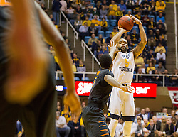 Jan 9, 2016; Morgantown, WV, USA; West Virginia Mountaineers guard Jaysean Paige (5) shoots a three pointer during the first half against the Oklahoma State Cowboys at the WVU Coliseum. Mandatory Credit: Ben Queen-USA TODAY Sports