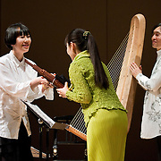 """February 18, 2012 - New York, NY : .From left, composer Akiko Yamane congratulates Mayumi Miyata and Fuyuhiko Sasaki after Mayumi and Fuyuhiko performed the World Premiere of Akiko Yamane's 'Dots Collection No. 13' (2012) during """"Resonances of the Kugo,"""" part of the 2012 New York Music From Japan Festival, at Merkin Concert Hall on Saturday. .CREDIT: Karsten Moran for The New York Times"""