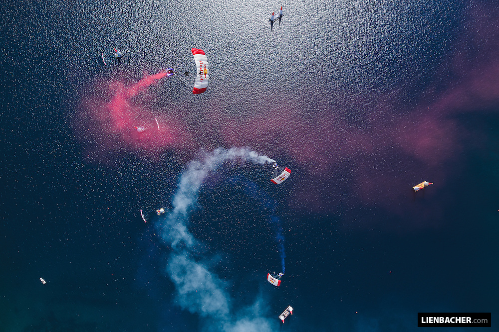 The Red Bull Skydive Team (Marco Waltenspiel, Marco Fuerst, Georg Lettner) fly the colors of the croatian flag using smoke while flying their canopies at the Red Bull Airrace in Rovinj, Croatia. 31st of May 2015. Photo: Wolfgang Lienbacher
