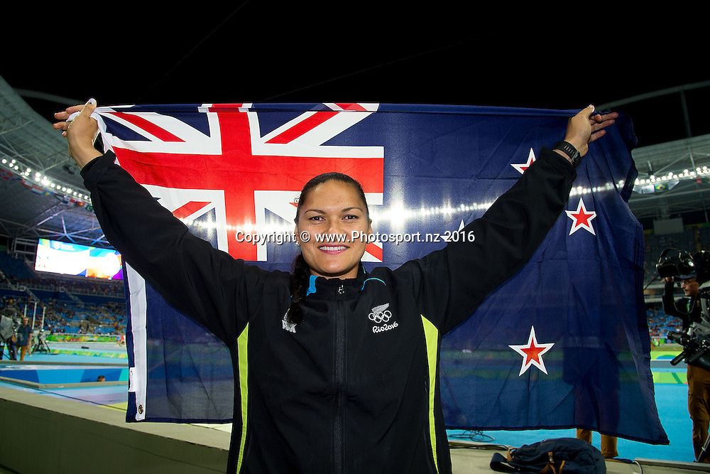 New Zealand's Valerie Adams poses for a photo with the New Zealand flag during a medal ceremony for the Women's Shot Put in Olympic Stadium at the 2016 Rio Olympics on Saturday the 13th of August 2016. © Copyright Photo by Marty Melville / www.Photosport.nz