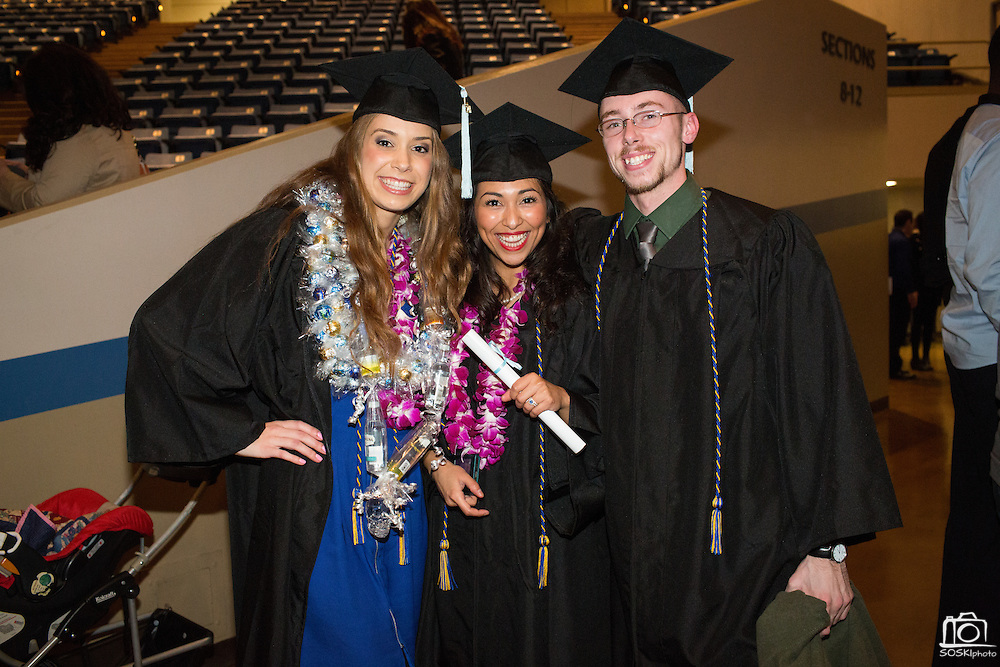 San Jose State University department of Child & Adolescent Development graduates pose for a portrait during their graduation ceremony at San Jose State University's Event Center Arena in San Jose, California, on December 18, 2014. (Stan Olszewski/SOSKIphoto)