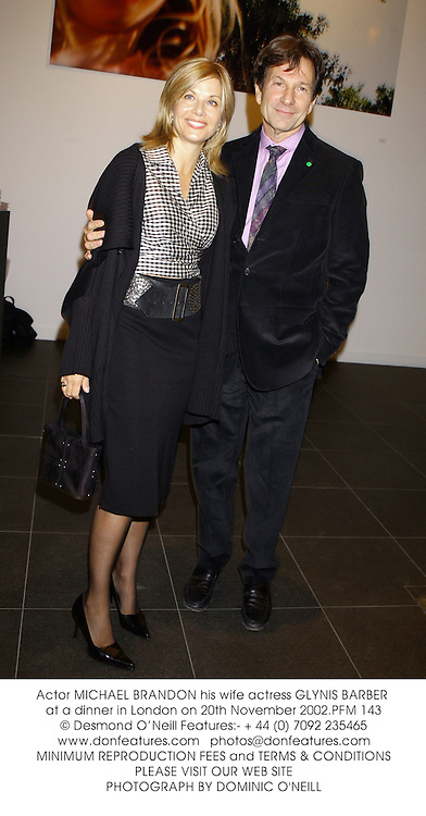 Actor MICHAEL BRANDON his wife actress GLYNIS BARBER at a dinner in London on 20th November 2002.PFM 143