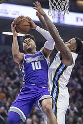 December 31, 2017 - Sacramento, CA, USA - The Sacramento Kings' Frank Mason III (10) is fouled by the Memphis Grizzlies' Mario Chalmers on Sunday, Dec. 31, 2017, at the Golden 1 Center in Sacramento, Calif. (Credit Image: © Hector Amezcua/TNS via ZUMA Wire)