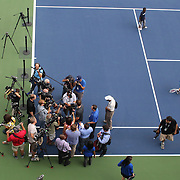 Andy Murray conducts a press conference as children who participated in a youth tennis clinic with Andy Murray and Serena WIlliams continue to play tennis. Flushing. New York, USA. 22nd August 2013. Photo Tim Clayton