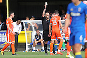Shrewsbury Town defender James Bolton (13) yellow card during the EFL Sky Bet League 1 match between AFC Wimbledon and Shrewsbury Town at the Cherry Red Records Stadium, Kingston, England on 12 August 2017. Photo by Matthew Redman.