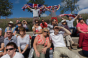 Spectators cheer on Team GB's Rebecca Adlington in a swimming heat in the Olympic Park during the London 2012 Olympics. Holding their union jack's over their heads, two men shout and whoop their support as Adlington comes in first for her 800m race. This land was transformed to become a 2.5 Sq Km sporting complex, once industrial businesses and now the venue of eight venues including the main arena, Aquatics Centre and Velodrome plus the athletes' Olympic Village. After the Olympics, the park is to be known as Queen Elizabeth Olympic Park.