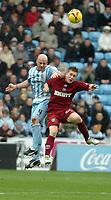 Photo: Ed Godden.<br />Coventry City v Brighton & Hove Albion. Coca Cola Championship. 04/02/2006. <br />Coventry's Robert Page (L) and Jake Robinson clash in the air.