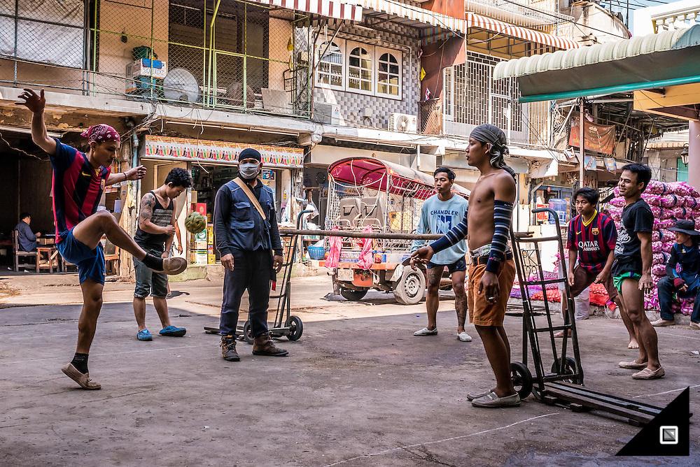 Sepak Takraw Players in Bangkok Downtown