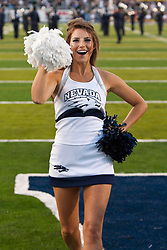 September 17, 2010; Reno, NV, USA; A Nevada Wolf Pack cheerleader performs on the field before the game against the California Golden Bears at Mackay Stadium. Nevada defeated California 52-31.