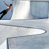 An unhelmeted skater climbs the wall of one of the bowls at the Scotts Valley Skate Park.<br /> Shmuel Thaler/Sentinel<br /> SAVED 4/17 IN G-WIP-LOCAL AND LOCAL-WORKFLOW