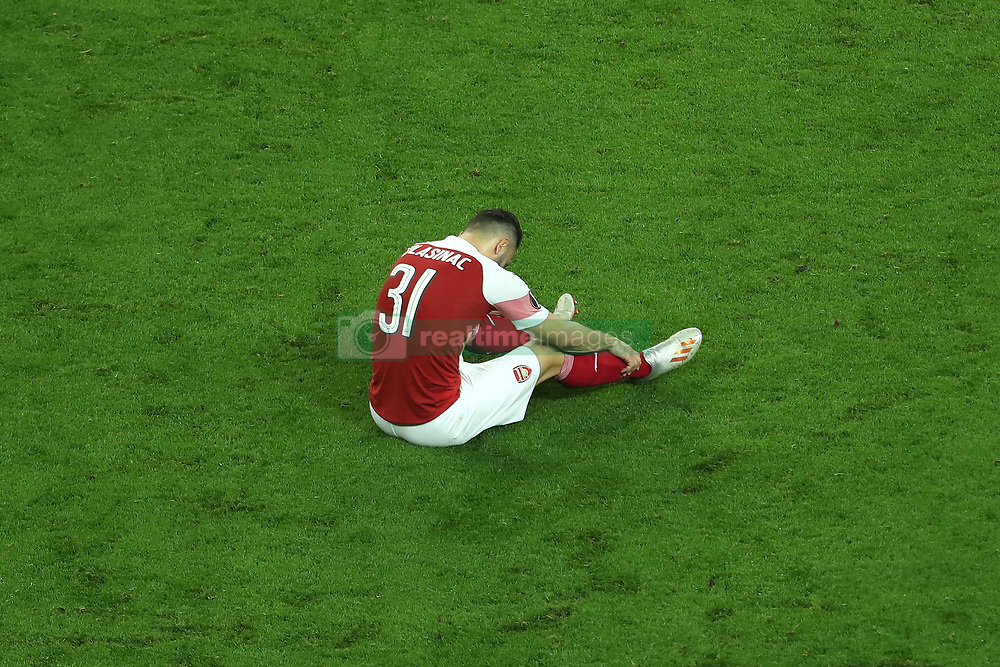 Arsenal's Sead Kolasinac looks dejected at full time during the UEFA Europa League final at The Olympic Stadium, Baku, Azerbaijan.