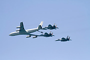 3 Israeli Air force Fighter jet F-15 being refueled by a Boeing 707 in flight