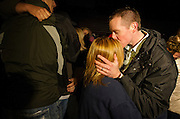 Robbie Parker kisses the forehead of a mourner during the community memorial vigil at Ben Lomond High School in Ogden for Emilie Parker, one of the children murdered during the recent school shooting at Sandy Hook Elementary, Thursday, Dec. 20, 2012