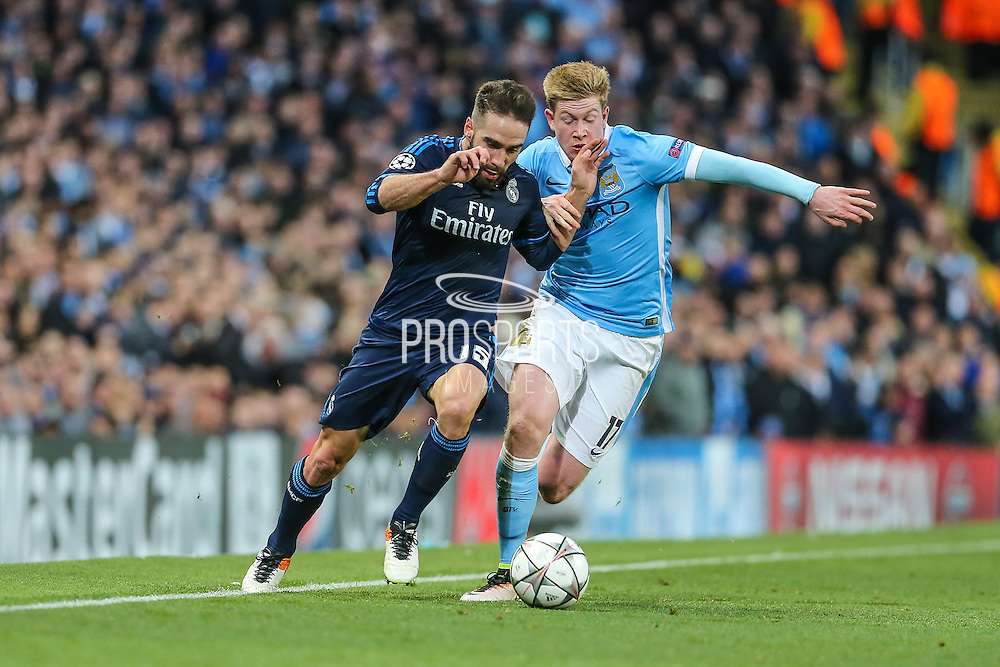 Real Madrid's Daniel Carvajal fends off Manchester City's Kevin De Bruyne during the Champions League match between Manchester City and Real Madrid at the Etihad Stadium, Manchester, England on 26 April 2016. Photo by Shane Healey.