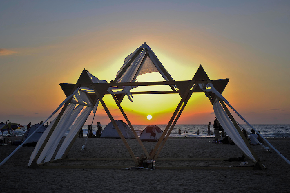"Sunset over the Temple at ""Mid Burn"", the Israeli ""Burning Man Festival"" held at ""Habonim"" beach north of Israel October 4-6, 2012."
