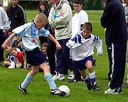 Eoin Griffin, Salthill Devon U-10 tackles Eoin Duffy, Newcastle in Fahy's Field Galway. Photo:Andrew Downes.