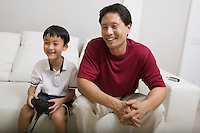 Father and Son on Couch Playing Video Game