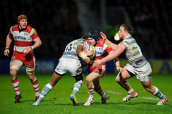 Gloucester Full Back (#15) Rob Cook is tackled by London Irish Outside Centre (#13) Sailosi Tagicakibau during the second half of the match - Photo mandatory by-line: Rogan Thomson/JMP - Tel: Mobile: 07966 386802 05/01/2013 - SPORT - RUGBY - Kingsholm Stadium - Gloucester. Gloucester Rugby v London Irish - Aviva Premiership.