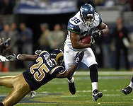 Seattle running back Mack Strong (38) rushes past St. Louis safety Corey Chavous (25) late in the fourth quarter at the Edward Jones Dome in St. Louis, Missouri, October 15, 2006.  The Seahawks beat the Rams 30-27.<br />