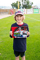 KELOWNA, CANADA - JUNE 28: A young fan during the opening charity game of the Home Base Slo-Pitch Tournament fundraiser for the Kelowna General Hospital Foundation JoeAnna's House on June 28, 2019 at Elk's Stadium in Kelowna, British Columbia, Canada.  (Photo by Marissa Baecker/Shoot the Breeze)