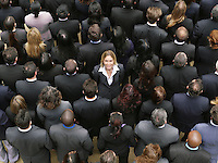 Back view of large group of business people woman facing opposite direction elevated view