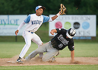 Mike Krische slides in safely to second ahead of the throw to Cornelius Copeland during Wednesday nights Muskrats game with the Vermont Mountaineers under the lights at Robbie Mills Field.  (Karen Bobotas/for the Laconia Daily Sun)