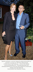 TRINNY WOODALL and her husband JONNY ELICHAOFF at a dinner in London on 19th May 2003.PJS 203
