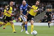 Ipswich Town midfielder James Norwood and Burton Albion midfielder John-Joe O'Toole challenge for the ball during the EFL Sky Bet League 1 match between Burton Albion and Ipswich Town at the Pirelli Stadium, Burton upon Trent, England on 3 August 2019.